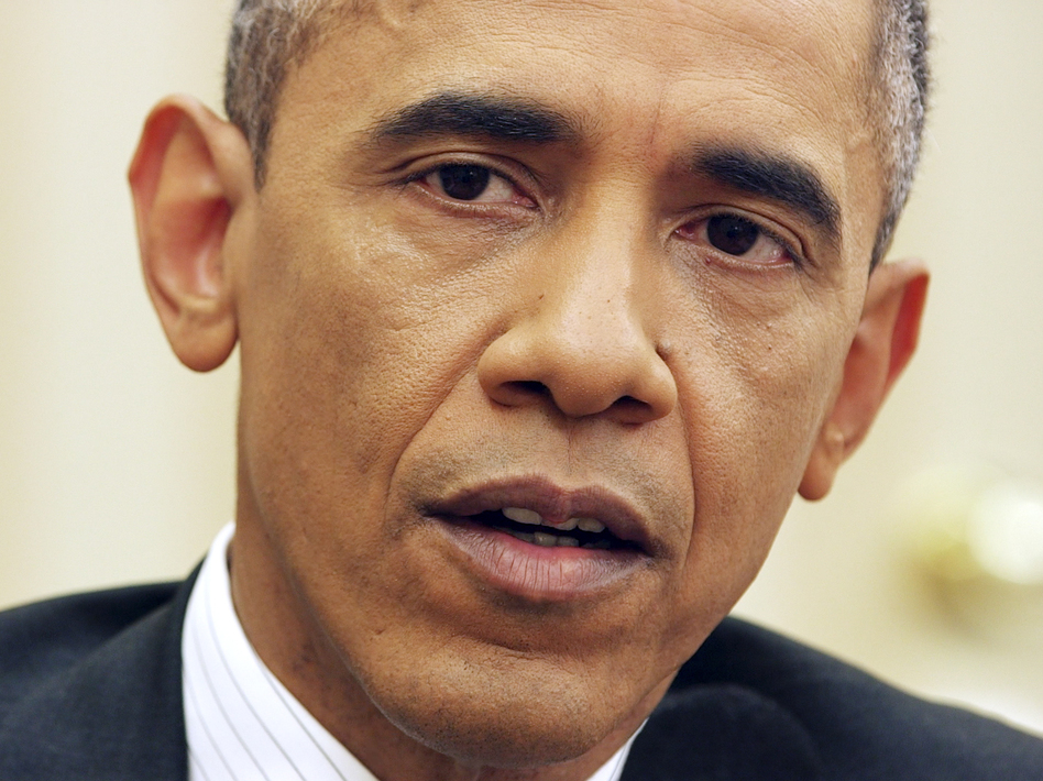 President Obama responds to a question from NPR's Steve Inskeep on Dec. 17 in the Oval Office. (Mito Habe-Evans/NPR)