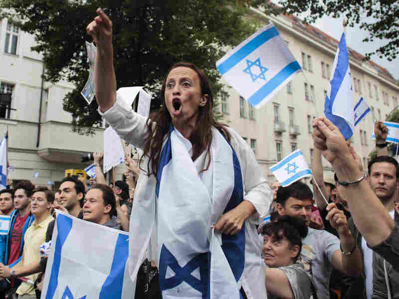 Pro-Israel demonstrators shout slogans July 25 while protesting against a pro-Palestinian rally in Berlin. About 1,200 pro-Palestinian demonstrators marched through Berlin amid high tensions over Israel's actions in Gaza, while some 700 protesters took part in two counter-demonstrations.