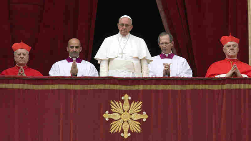"""Pope Francis delivers his """"Urbi et Orbi"""" (to the city and to the world) blessing from the central balcony of St. Peter's Basilica at the Vatican, on  Christmas Day."""