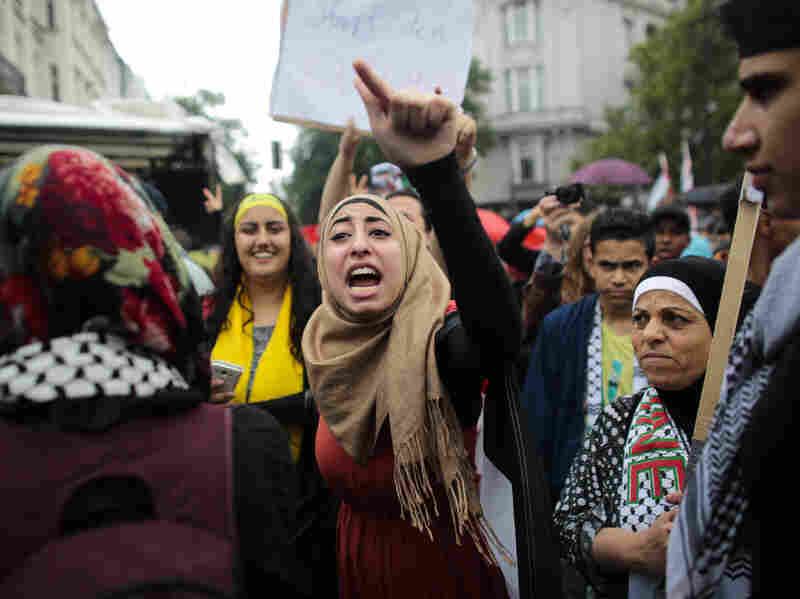 A woman shouts slogans as she attends a pro-Palestinian rally July 25 in Berlin. About 1,200 pro-Palestinian demonstrators marched through Berlin amid high tensions over Israel's actions in Gaza, while some 700 protesters took part in two counter-demonstrations.