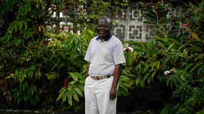 Dr. Senga Omeonga pictured outside St. Joseph's Catholic Hospital in Monrovia. Dr. Omeonga moved to Liberia from DRC in 2011. He contracted Ebola but survived it.