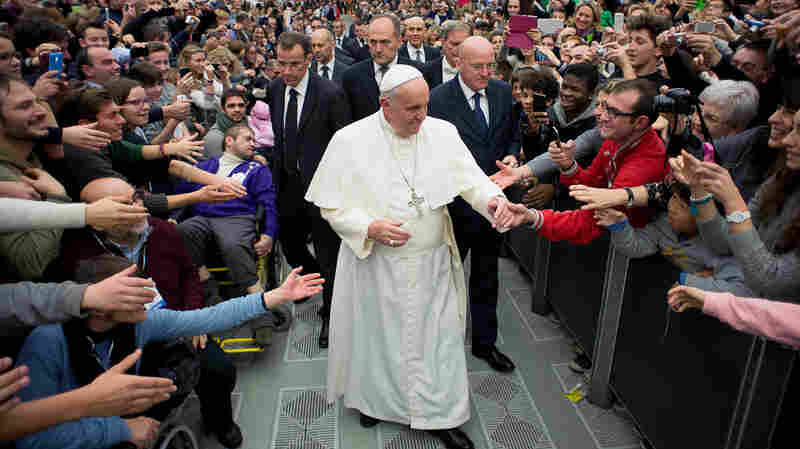 Pope Francis salutes the faithful during a meeting with members of the Pope John XXIII Community association in the Paul VI hall at the Vatican on Dec. 20. The first pope from the global south wants to reshape the church for the