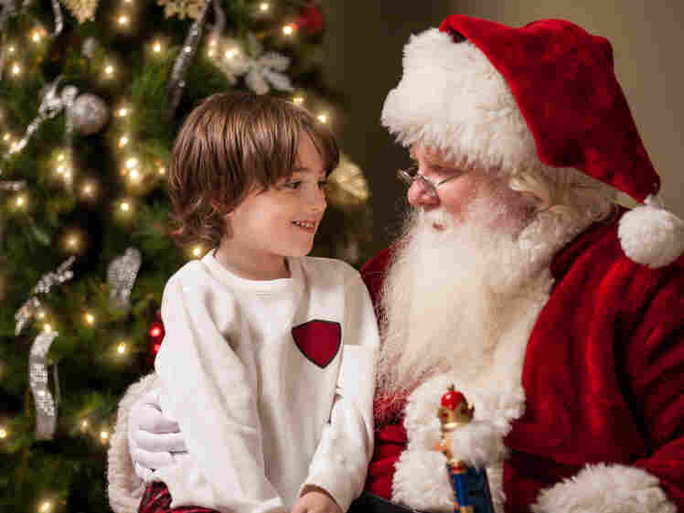 A young boy with Santa Claus.