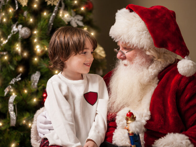 a young boy with santa claus - Santa Claus Children