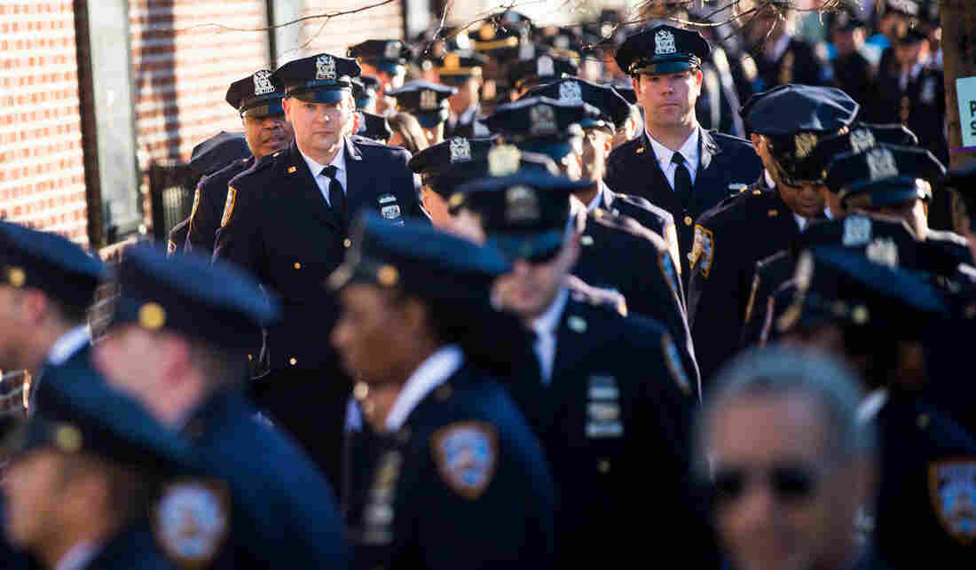 New York City police officers attend the wake of their fellow NYPD officer.