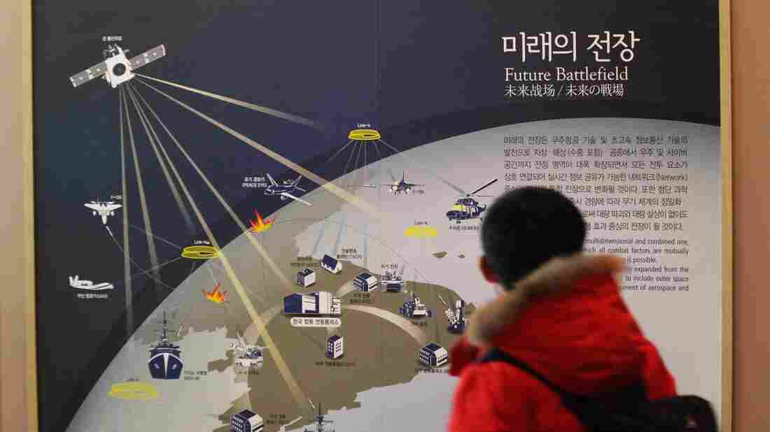 A South Korean student looks Dec. 23 at a diagram at Korea War Memorial Museum in Seoul, South Korea, that depicts how the cyberwarfare will be waged in the future in the Korean Peninsula.