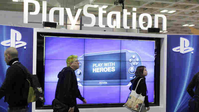 Attendees walking past the Sony PlayStation booth at the Game Developers Conference in San Francisco in 2012. The PlayStation and Microsoft's Xbox consoles were experiencing a possible hack on their online sites.