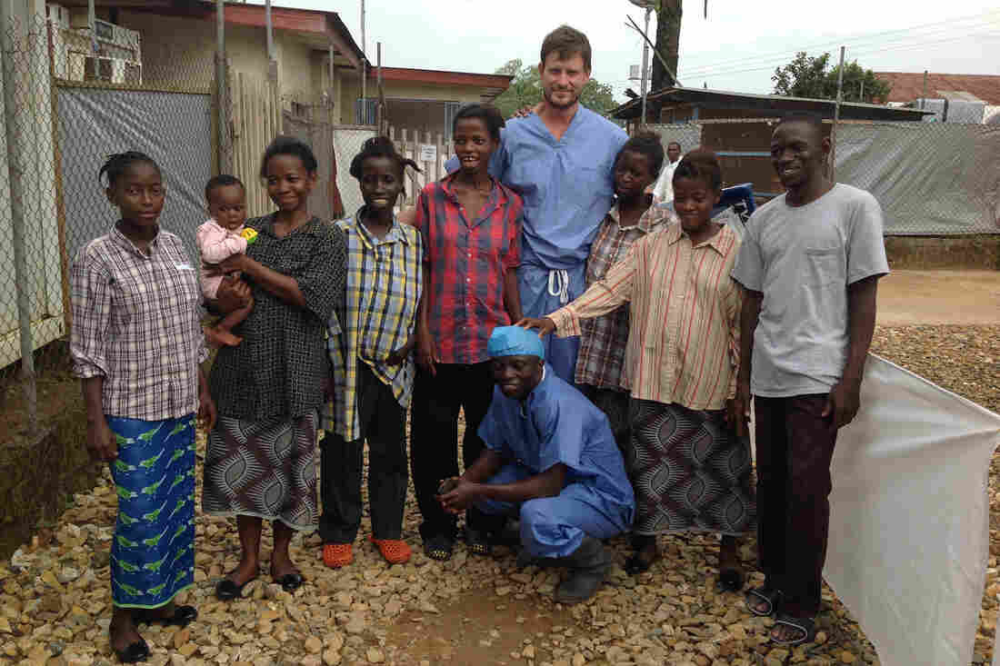 Dr. Ian Crozier stands with a group of survivors and a nurse at the Kenema Government Hospital in Sierra Leone. He contracted Ebola and was on the brink of death, but he survived.