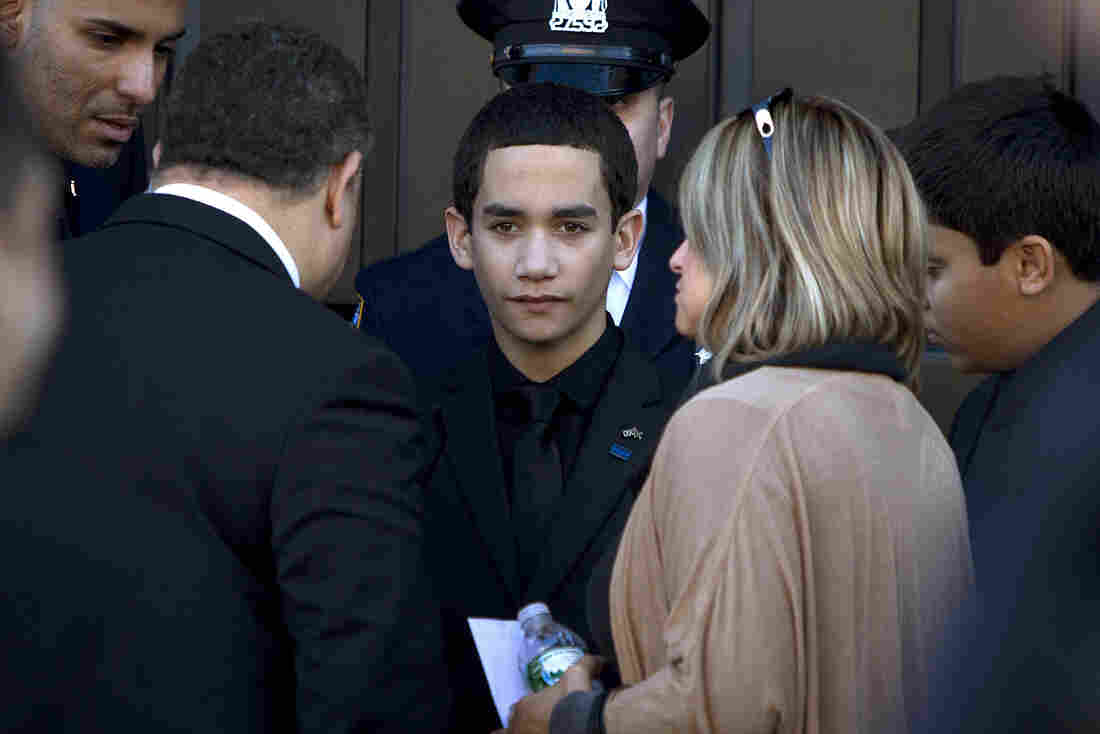 Jaden Ramos, son of slain NYPD officer Rafael Ramos, arrives for his father's wake at Christ Tabernacle Church in Queens, N.Y., on Friday.