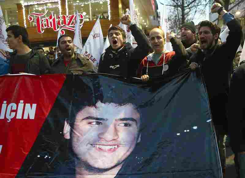 "Turkish demonstrators hold a banner with a photo of Mehmet Emin Altunses, who was released from jail Friday, two days after his arrest. The 16-year-old was accused of ""insulting"" President Recep Tayyip Erdogan."