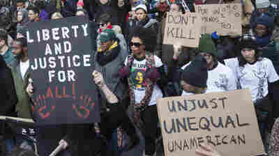 Demonstrators march in New York after grand juries failed to indict police officers in the deaths of Eric Garner and Michael Brown. Many are calling for the officers to be tried before a jury of their peers.