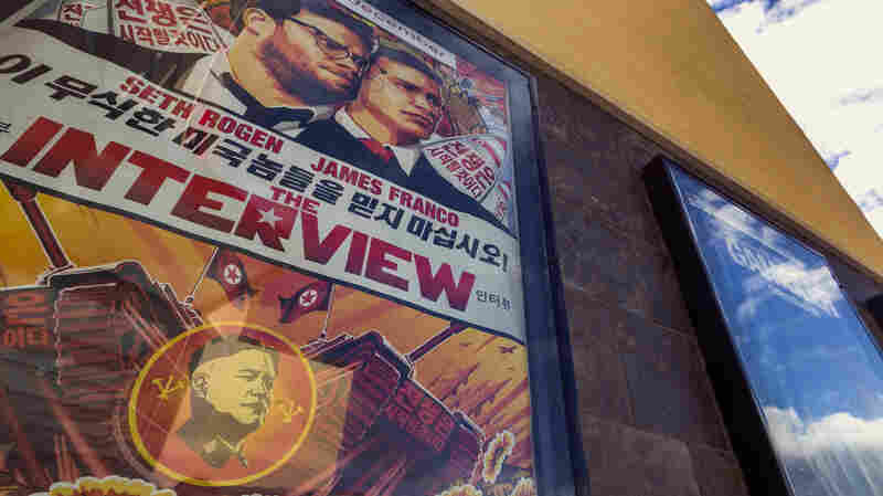 A poster for The Interview stands on display outside a movie theater in Glendora, Calif., on Wednesday.