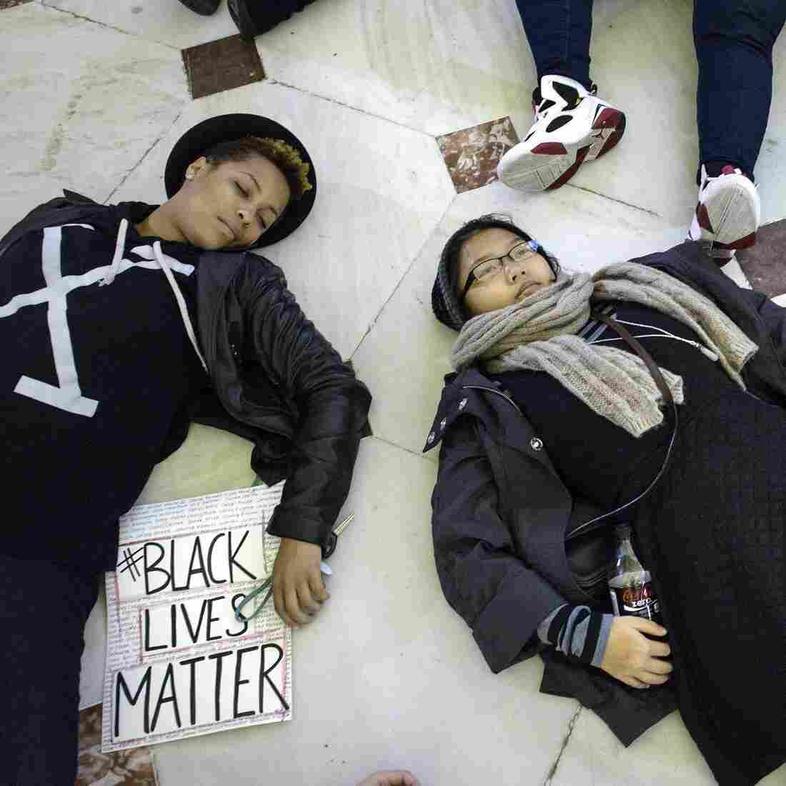 """Die-ins, like this one at Union Station in Washington, D.C., on Dec. 6, were conducted across America to protest grand jury decisions not to indict the police officers who killed Michael Brown and Eric Garner. Linguist Ben Zimmer says that while the word """"die-in"""" isn't new, its increased use makes it a strong candidate for the American Dialect Society's 2014 Word of the Year."""