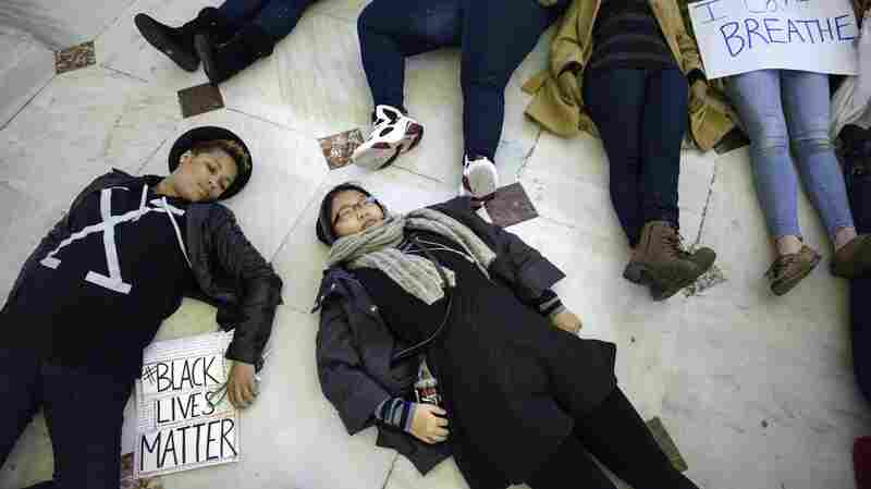 "Die-ins, like this one at Union Station in Washington, D.C., on December 6, were conducted across America to protest the non-indictment of the police officers who killed Michael Brown and Eric Garner. Linguist Ben Zimmer says that while the word ""die-in"" isn't new, its increased use makes it a strong candidate for the American Dialect Society's 2014 Word of the Year."