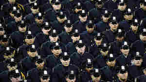 Cadets stand during the New York Police Department graduation ceremony at Madison Square Garden on Monday.