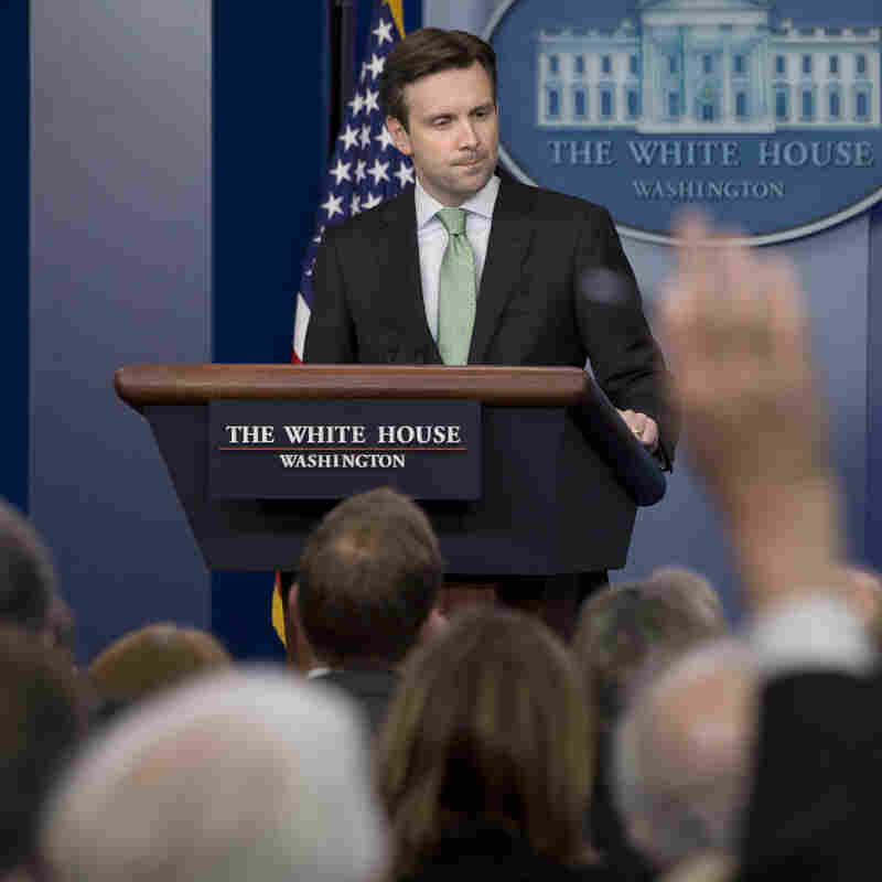 White House press secretary Josh Earnest takes questions from the press during a daily briefing in December.