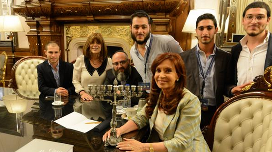 Argentine President Cristina Fernandez de Kirchner is seen with members of the Tawil family on Dec. 23. Kirchner embraced their seventh son, Yair, as her godson in line with an Argentine tradition that offers presidential protection to the seventh son in a family with only male children to prevent him from turning into a werewolf.