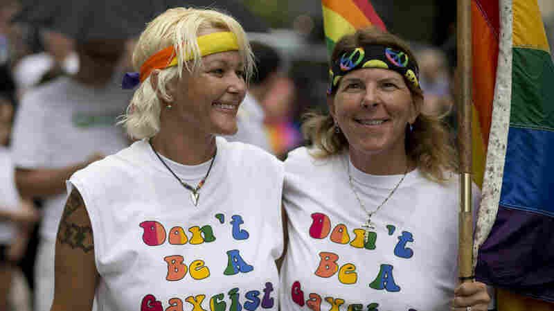 Kimmy Denny and her partner, Barb Lawrence of Palm Harbor, Fla., wait outside a court hearing on gay marriage in Miami in July. On Jan. 6, same-sex marriages will be allowed in the Sunshine State.