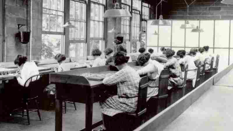 Employees of the U.S. Radium Corporation paint numbers on the faces of wristwatches using dangerous radioactive paint. Dozens of women, known as Radium Girls, later died of radium poisoning. The last radium girl died this year at 107.