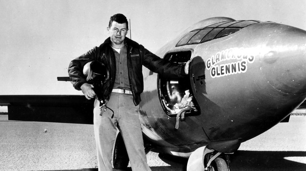 """Chuck Yeager, standing next to the """"Glamorous Glennis,"""" the Bell X-1 experimental plane in which he first broke the sound barrier."""
