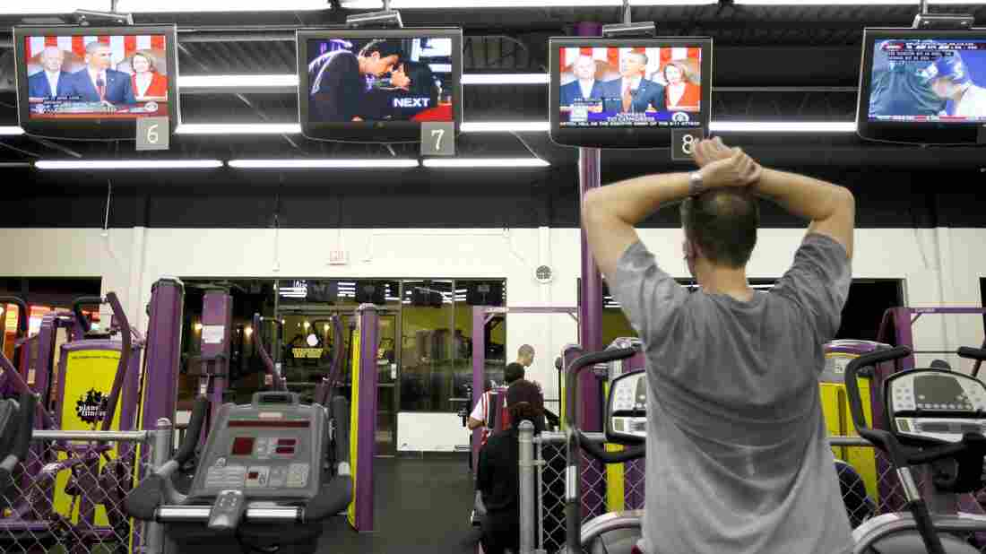 People exercising at Planet Fitness.
