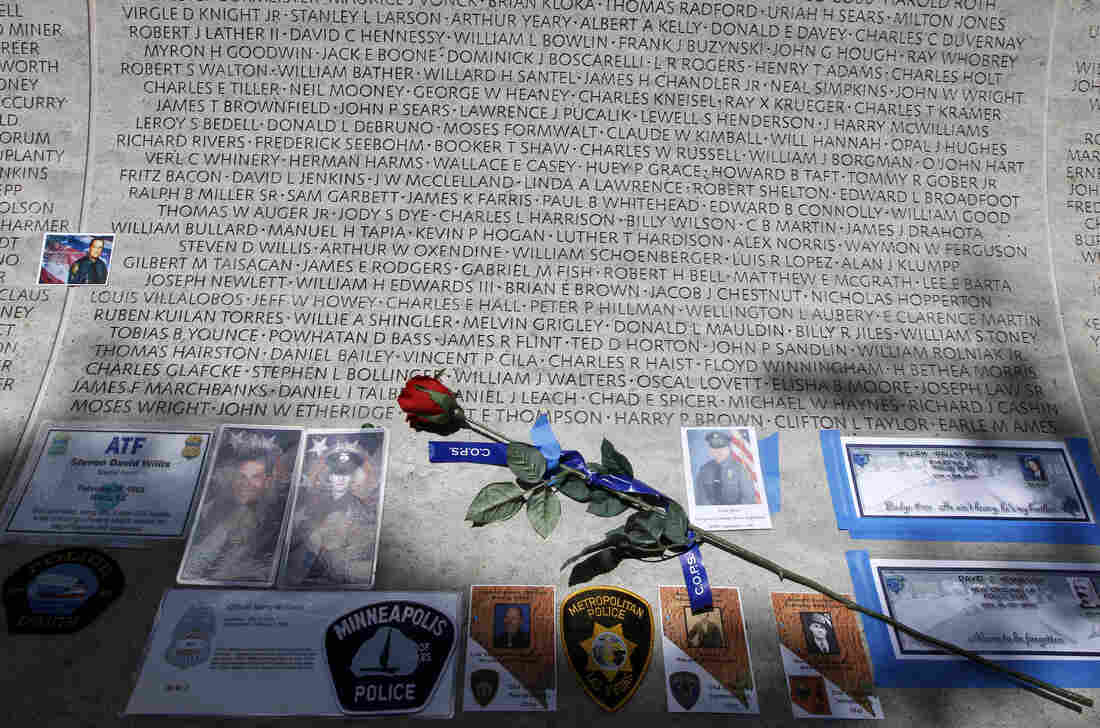 A rose is placed at the wall with the names of fallen police officers at the National Law Enforcement Officers Memorial in Washington during the National Police Week in 2013.
