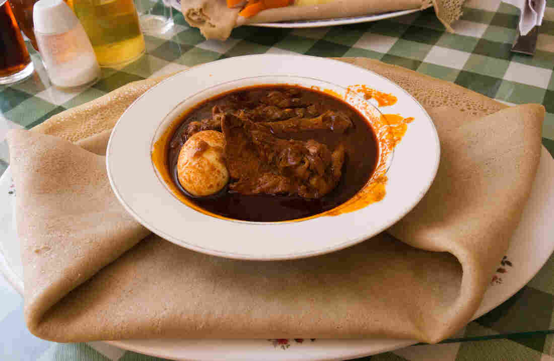 Doro wat, the traditional dish eaten in Ethiopia on Christmas Day, served with injera bread.