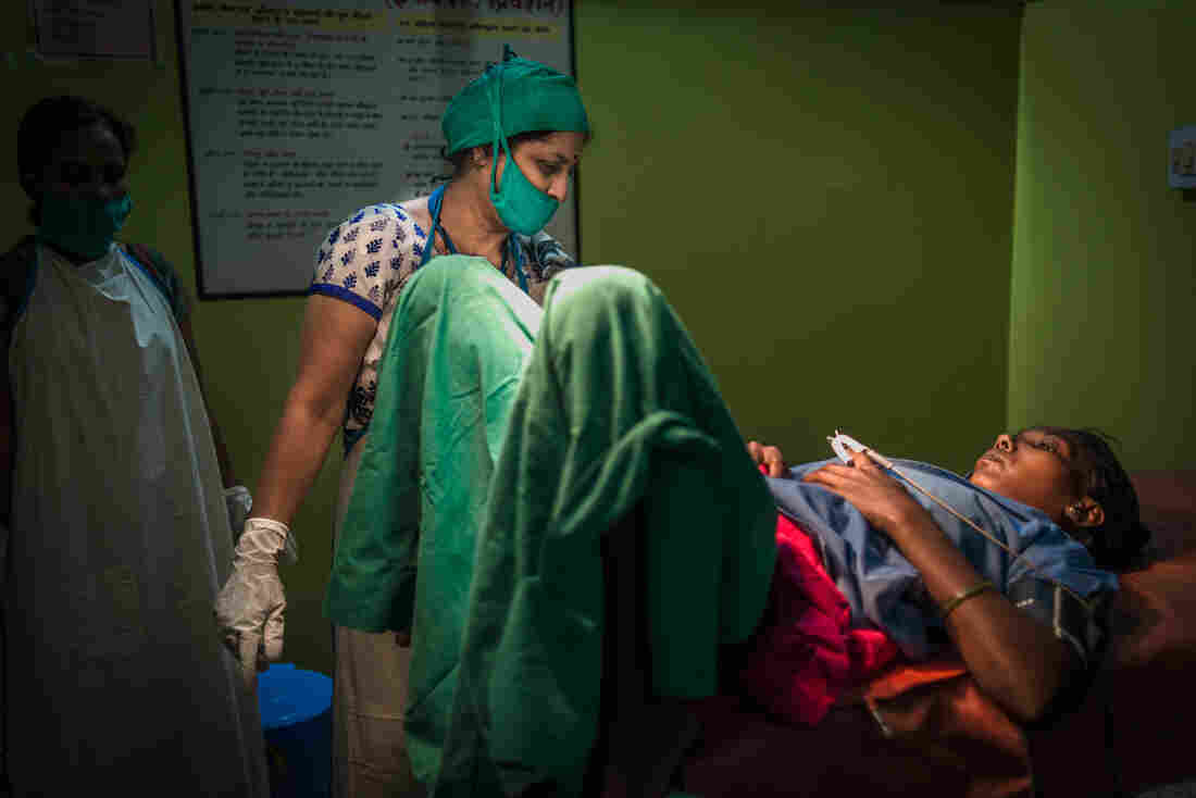 """Dr. Simmi Mahesh and Palo Khoya talk after the abortion. """"I was traumatized and terrified, wondering whether I would be in massive pain,"""" Khoya says. """"The doc reassured me and carried out the abortion safely."""" She now visits the doctor regularly for family planning advice. """"Women don't know the methods [of family planning],"""" Dr. Mahesh says. """"So the key is educating women."""""""
