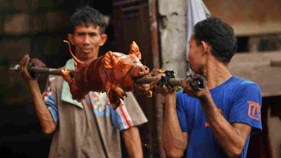 """""""Lechon,"""" or roasted pig, is often served at Philippine festivities, especially during Christmas and New Year's celebrations."""