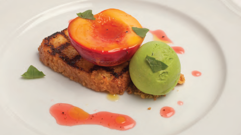 Grilled lemon pound cake topped with slow-roasted nectarines, basil gelato and olive oil drizzle. Yum.