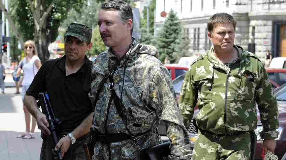 Igor Girkin, a Russian citizen who headed the pro-Russian rebels in eastern Ukraine last year, walks with his bodyguards in the eastern Ukrainian city of Donetsk in July.