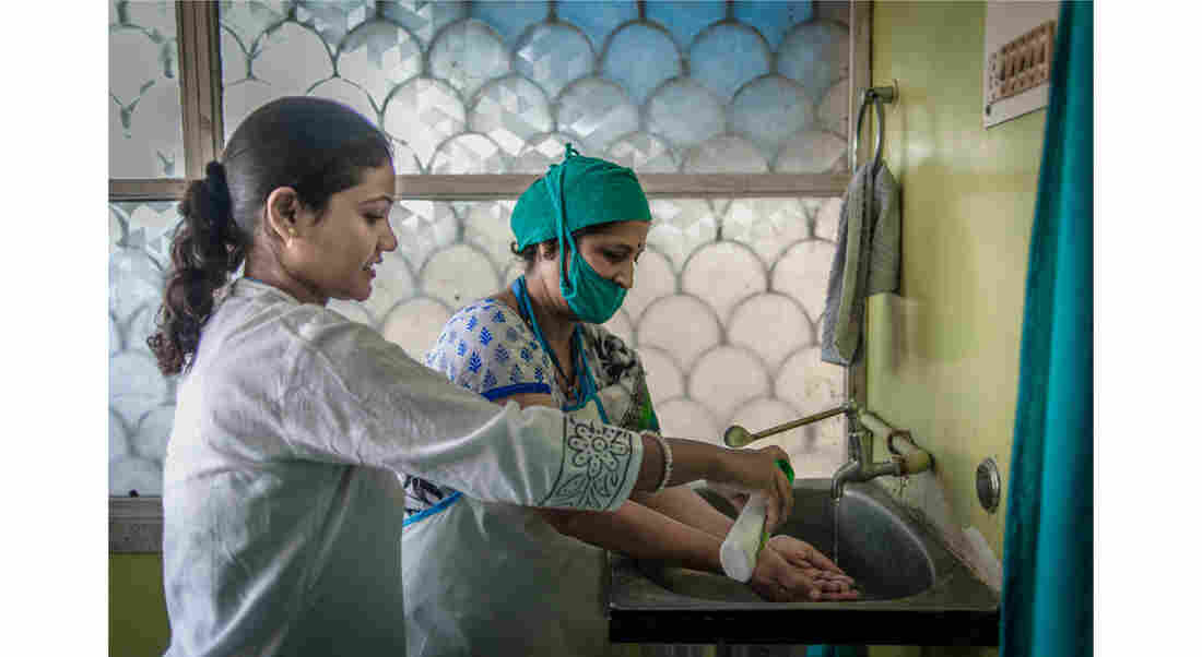 """Dr. Mahesh prepares to carry out an abortion for Palo Khoya. """"They just come because they don't want to continue the pregnancy,"""" the doctor says. """"They're not bothered whether it's legal or not legal. But we're doing awareness campaigns to tell them it's legal, it's not wrong, to get rid of the stigma attached to it."""""""