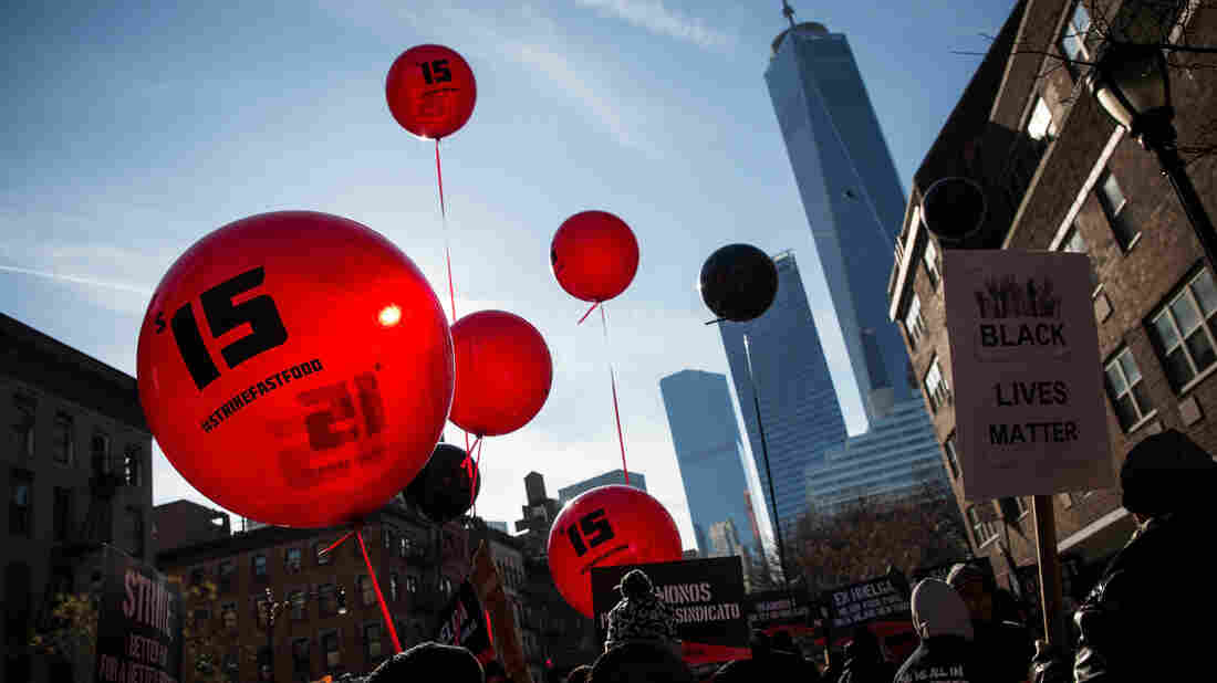 Protesters march in New York City on Dec. 4 to demand an increase in the minimum wage to $15 per hour. New York state's minimum wage rose to $8.75 on Wednesday.
