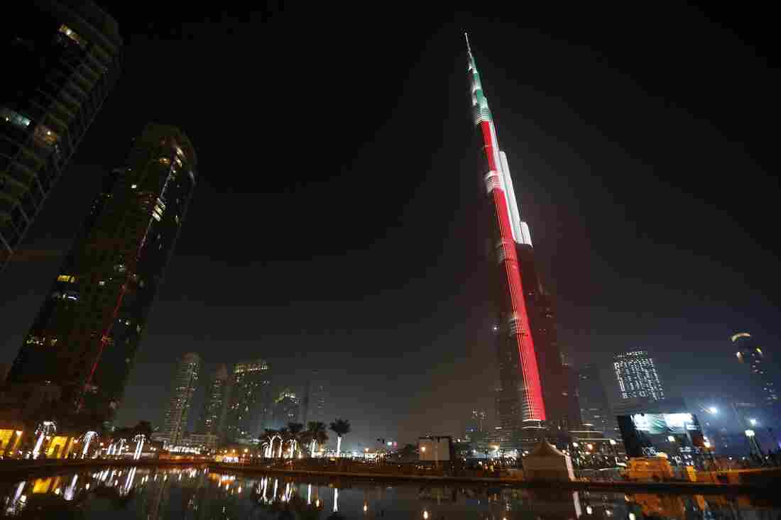 Lighting illuminates the Burj Khalifa tower in the colors of the Emirati flag early on New Year's Day in downtown Dubai.