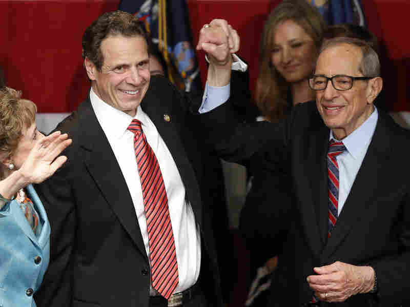 Democratic New York Gov. Andrew Cuomo celebrates his re-election in November at Democratic election headquarters in New York City with his father, former New York Gov. Mario Cuomo (right), and his mother, Matilda (left), after defeating Republican challenger Rob Astorino. Andrew Cuomo is the first Democratic governor to win re-election in New York since his father.