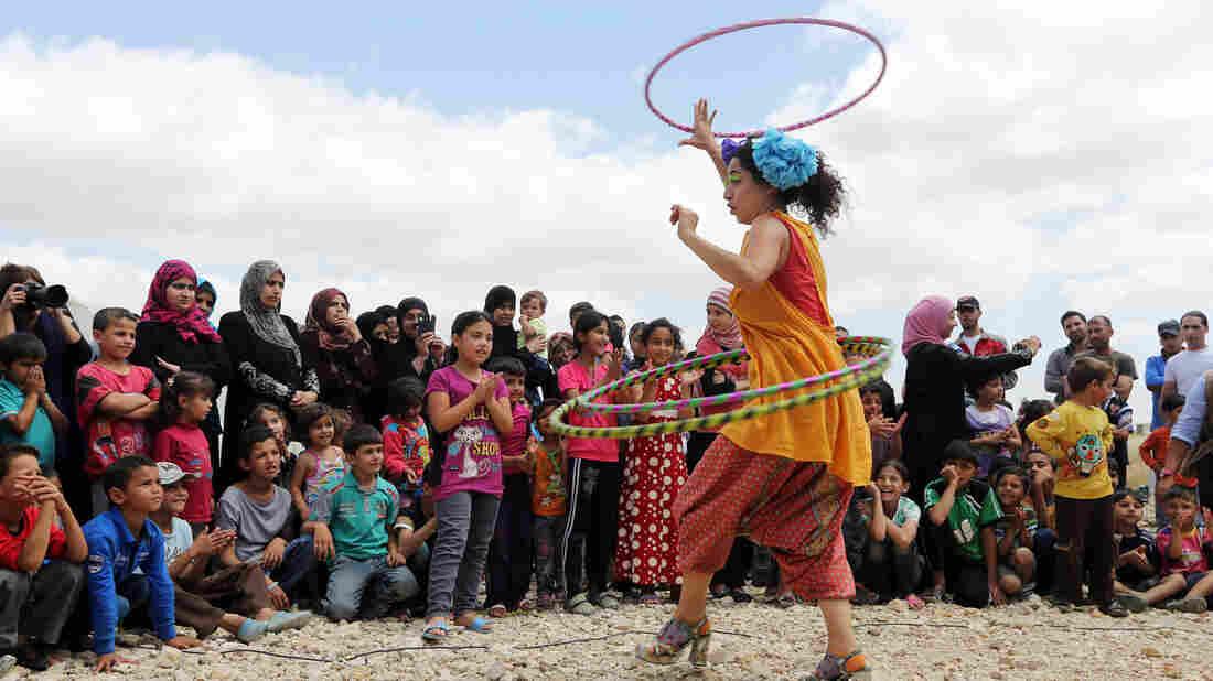 "Lebanese clown Sabine Choucair, a member of ""Clowns Without Borders,"" performs for children in June at a Syrian refugee camp in the eastern town of Chtoura, Lebanon."