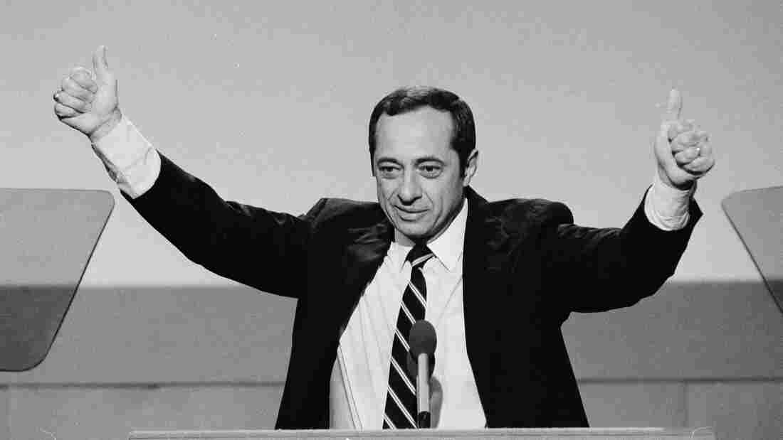 New York Gov. Mario Cuomo gives a thumbs-up gesture with both hands during his July 16, 1984, keynote address to the opening session of the Democratic National Convention in San Francisco.