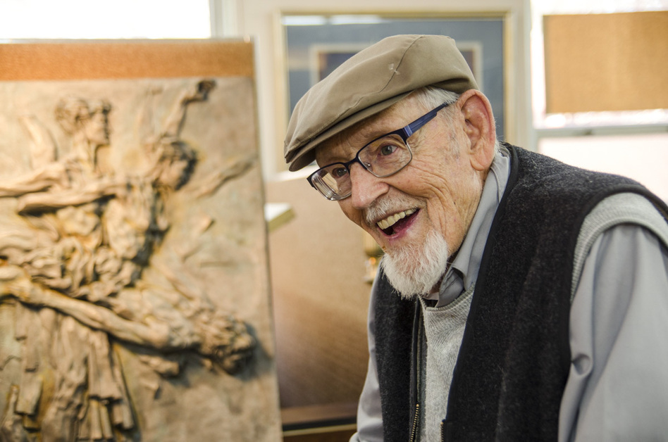 "Eric Bransby, pictured above in his home in Colorado Springs, is still creating art at 98. ""I try to make each mural a project that will somehow expand my abilities a little bit more,"" he says."