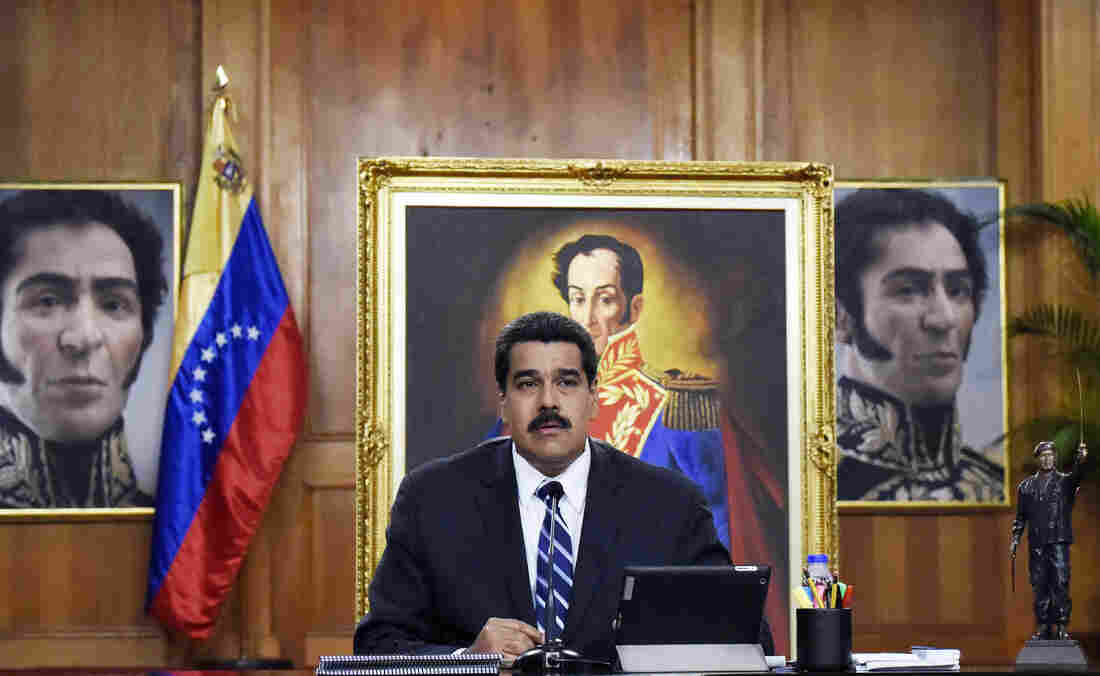 Venezuela's President Nicolas Maduro speaks at the presidential palace in the capital Caracas on Dec. 30, 2014. Venezuela's economy has entered a recession and is suffering from high unemployment, many shortages and inflation of more than 60 percent. The country depends heavily on oil exports and revenue is down sharply due to lower oil prices.