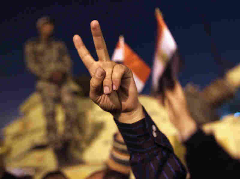 Anti-government demonstrators celebrated in Tahrir Square upon hearing the news of the resignation of Egyptian President Hosni Mubarak on Feb. 11, 2011.