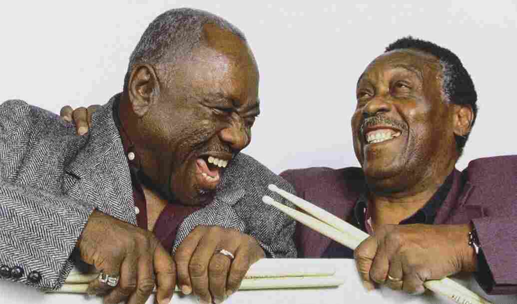 """John """"Jabo"""" Starks (left) and Clyde Stubblefield laid the grooves on many of James Brown's biggest hits. Here, they clown around on the cover of their joint DVD, Soul of the Funky Drummers."""