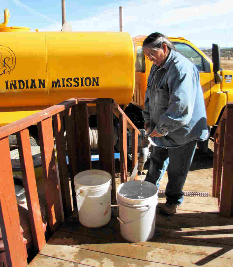 Darlene Arviso is known as the water lady in Smith Lake, N.M., on the Navajo Nation. She delivers water to 250 people each month. Here, she fills buckets from her water truck.