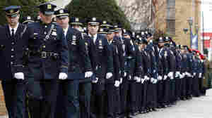 New York City police officers march before funeral services for police officer Wenjian Liu at Aievoli Funeral Home, in Brooklyn on Sunday. Liu and his partner were gunned down in an unprovoked attack on Dec. 20.
