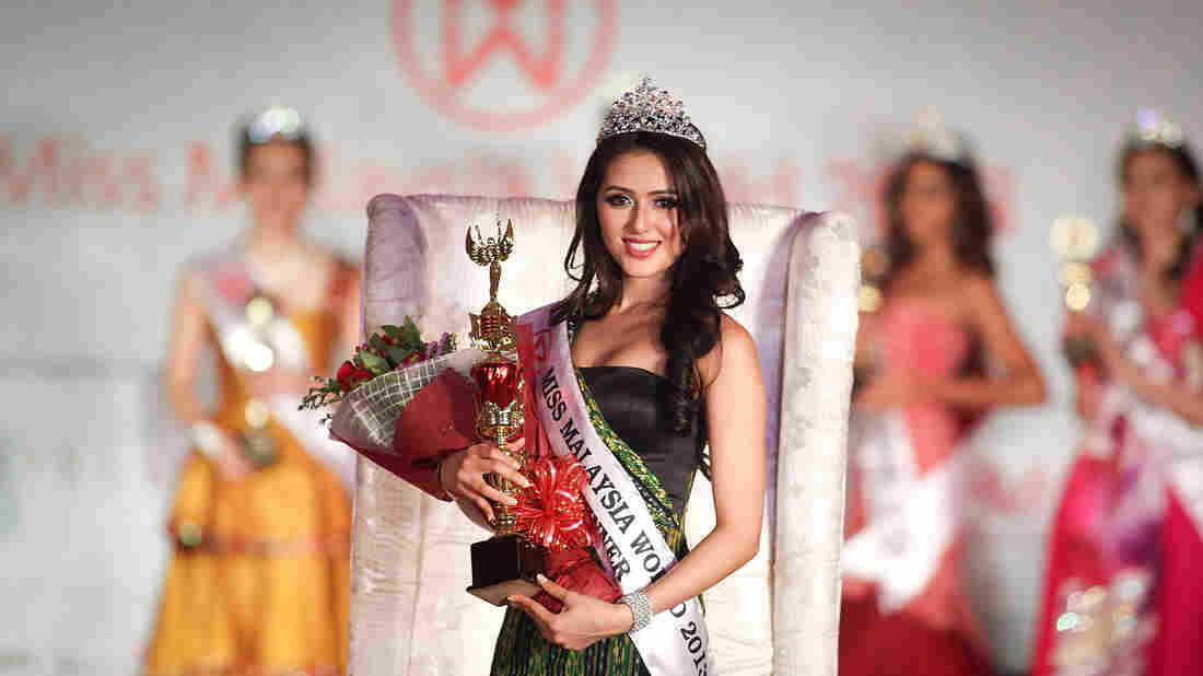 The winner of Miss Malaysia World 2013, Melinder Kaur Bhullar, poses during the grand finale on Aug. 2, 2013, in Kuala Lumpur, Malaysia. Four Muslim women were dropped as contestants after a religious decree, or fatwa,  barred them from participating.