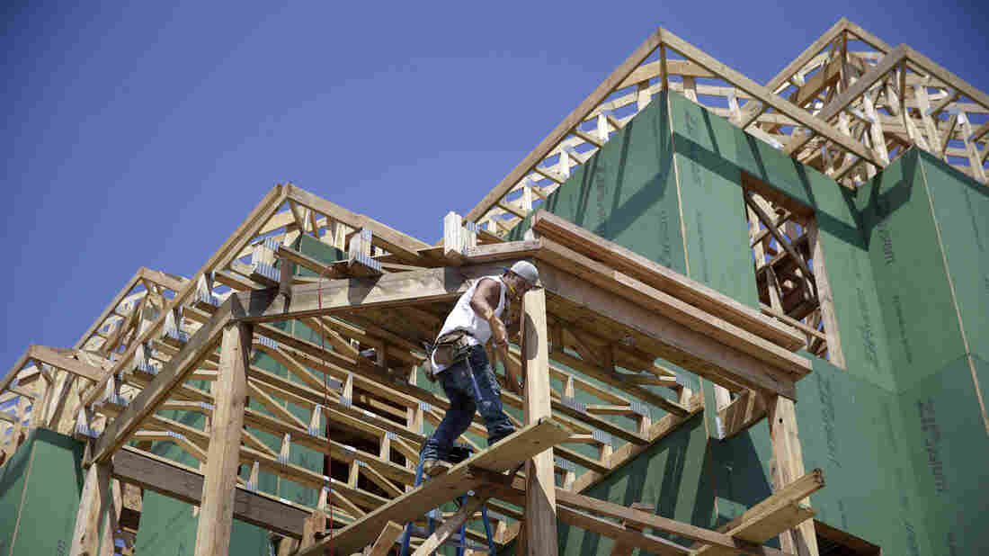 A builder works on the construction of new homes in Belmar, N.J. Increased hiring and a boost in consumer confidence are expected to lift the housing market this year.