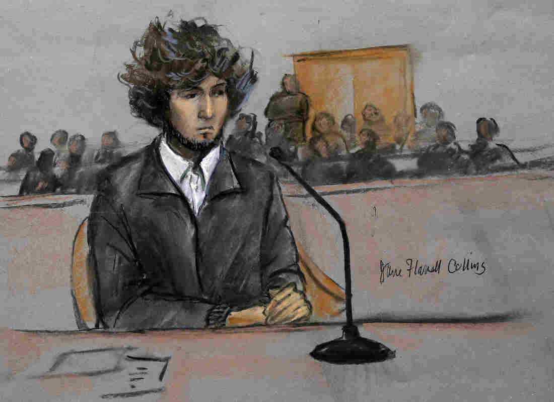 In this courtroom sketch, Boston Marathon bombing suspect Dzhokhar Tsarnaev is depicted sitting in federal court Thursday, Dec. 18, 2014, in Boston.
