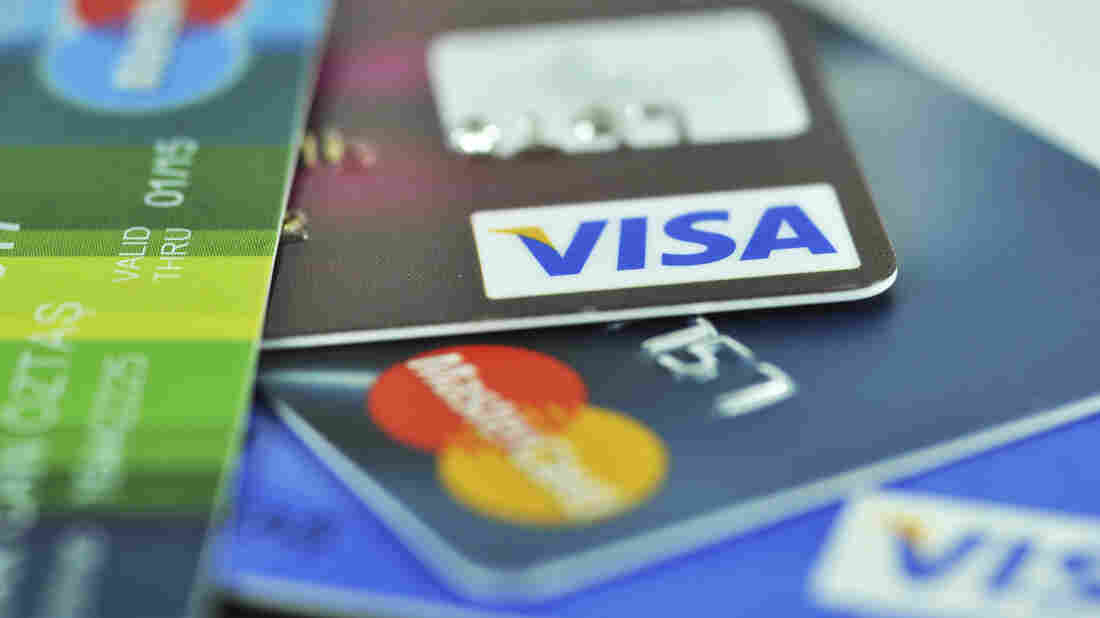 To protect against fraud, U.S. banks will be issuing credit cards with small computer chips. But some experts say using a PIN to complete a transaction is more secure than a signature.