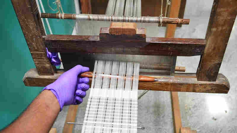 Using a simple wooden handloom, weavers create silk strips that diabetics can use as glucose sensors. This loom is at Achira Labs in Bangalore, India.