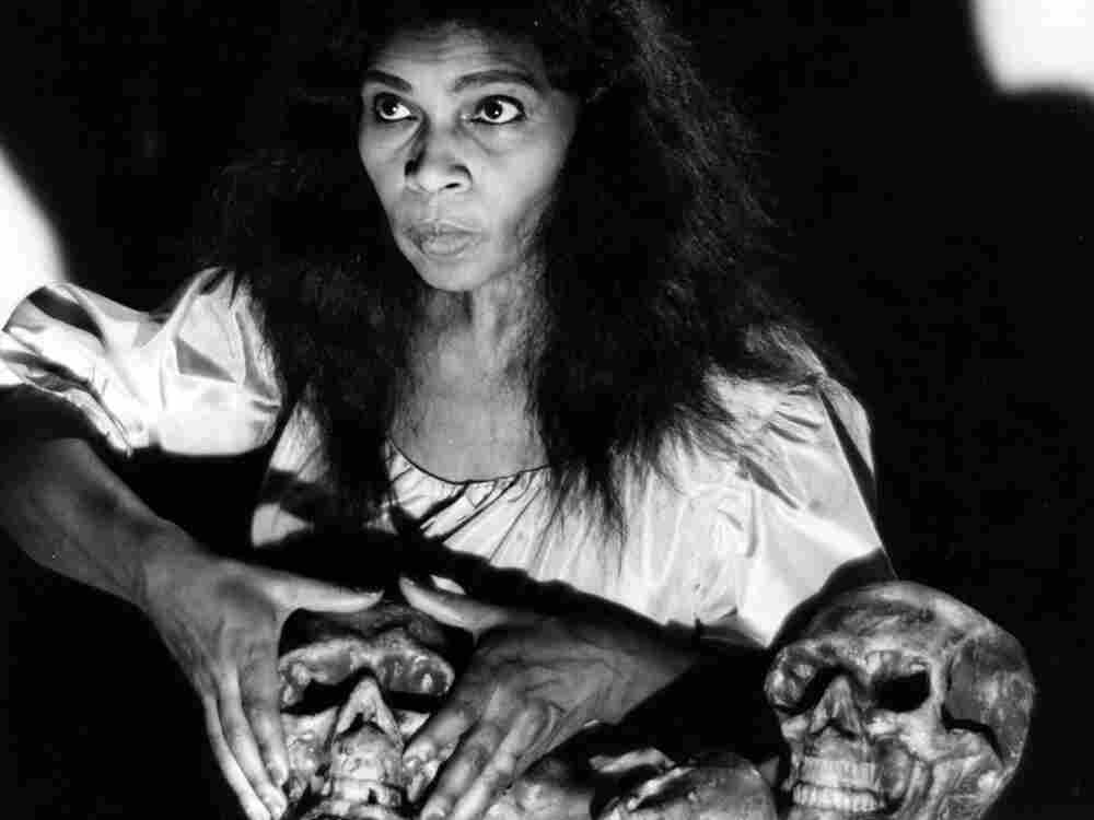 Contralto Marian Anderson in the role of Ulrica from a Metropolitan Opera production of Verdi's Un ballo en maschera in 1955. Anderson was the first African-American soloist to appear at the Met.