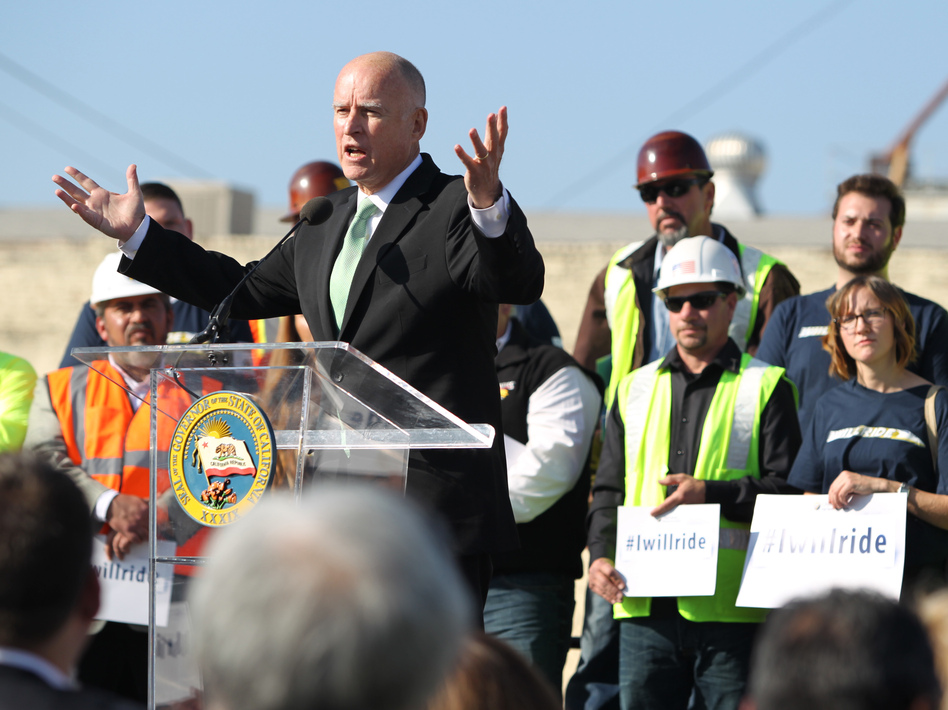 Gov. Jerry Brown speaks to the crowd during the California High-Speed Rail Authority groundbreaking event in Fresno. The $68 billion project faces challenges from Republicans in Congress, and from Central Valley farmers suing to block the train from crossing their fields.